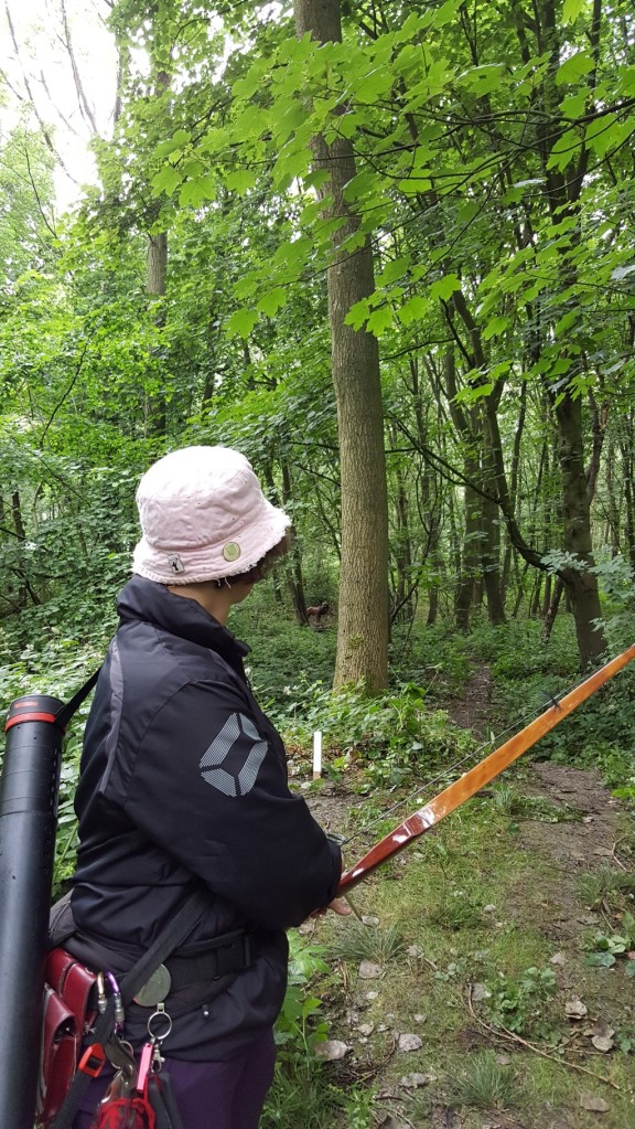 Sharon shooting 3D deer between trees