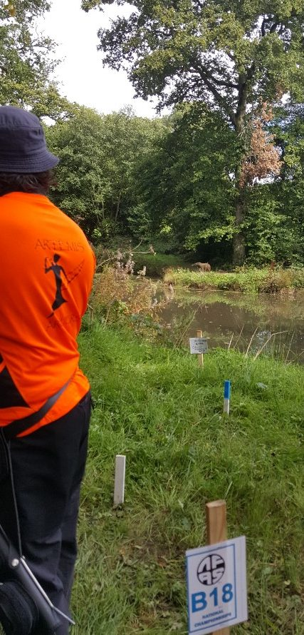 Ian shooting 3D bear on B course across pond