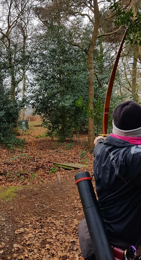 Sharon shooting a 3D dragon target at Paget de Vasey