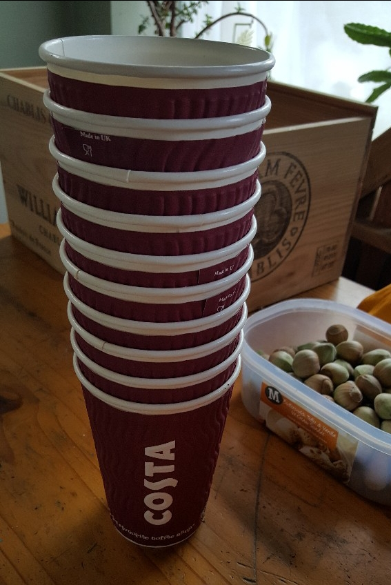 stack of Costa Coffee cups