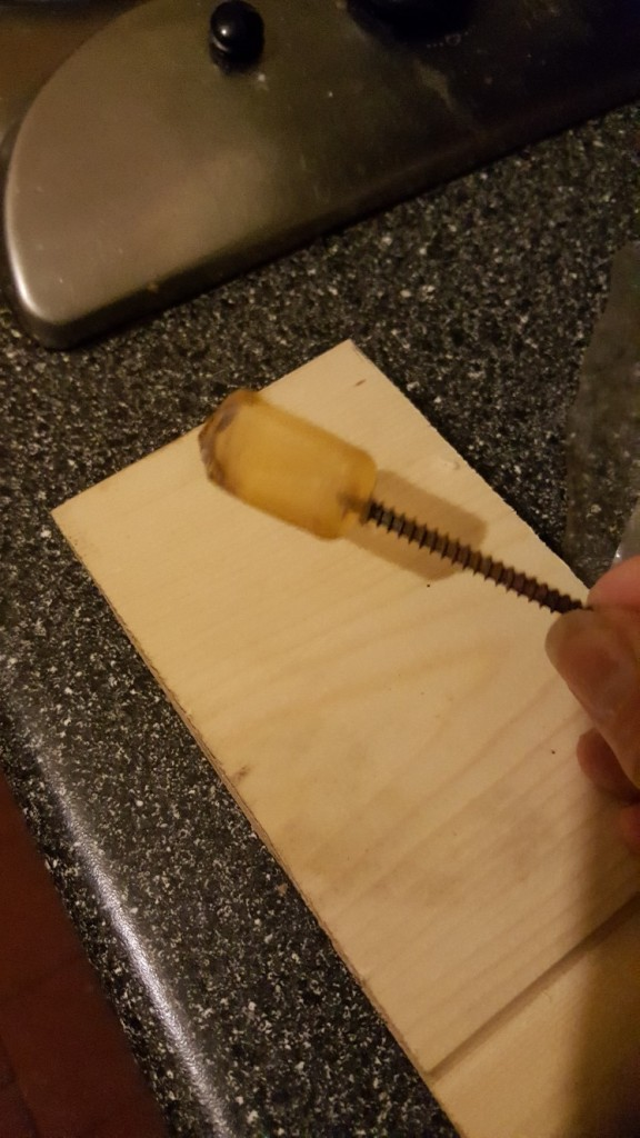 Hot-melt glue stub with a long wood screw attached